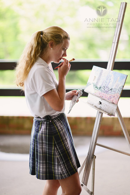 Commercial-education-photography-student-working-on-oil-painting-outdoors