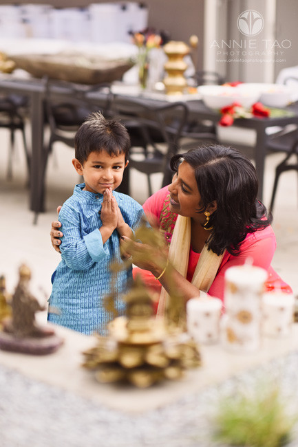 East-Bay-family-photography-mother-teaching-preschool-son-how-to-pray-at-alter-on-diwali