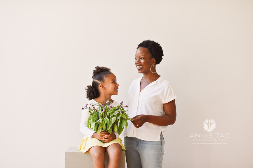 East-Bay-commercial-photography-smiling-mother-touches-fresh-basil-while-daughter-looks-up
