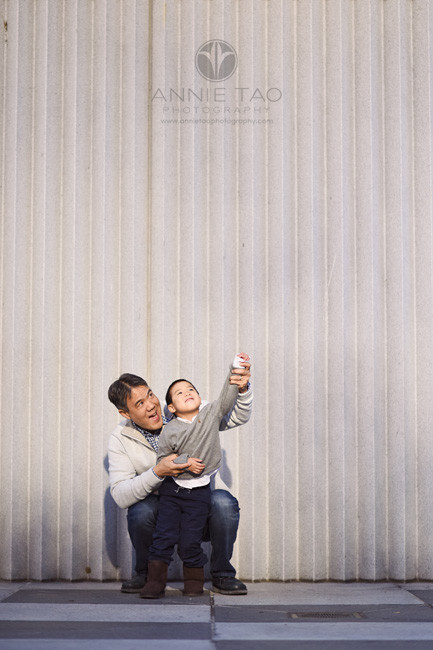 San-Francisco-lifestyle-family-photography-father-holding-sons-arms-downtown