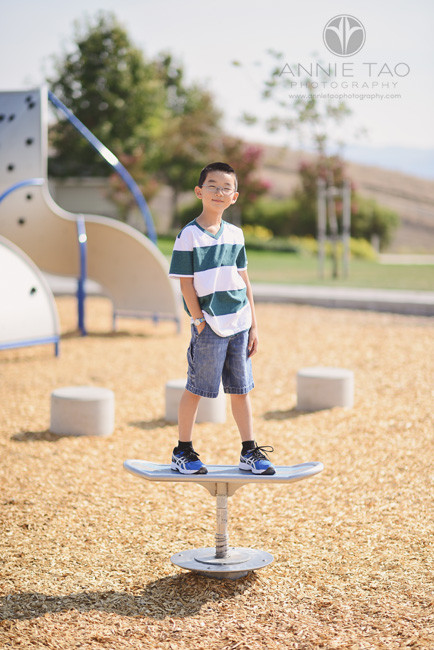 East-Bay-lifestyle-children-photography-smiling-boy-balancing