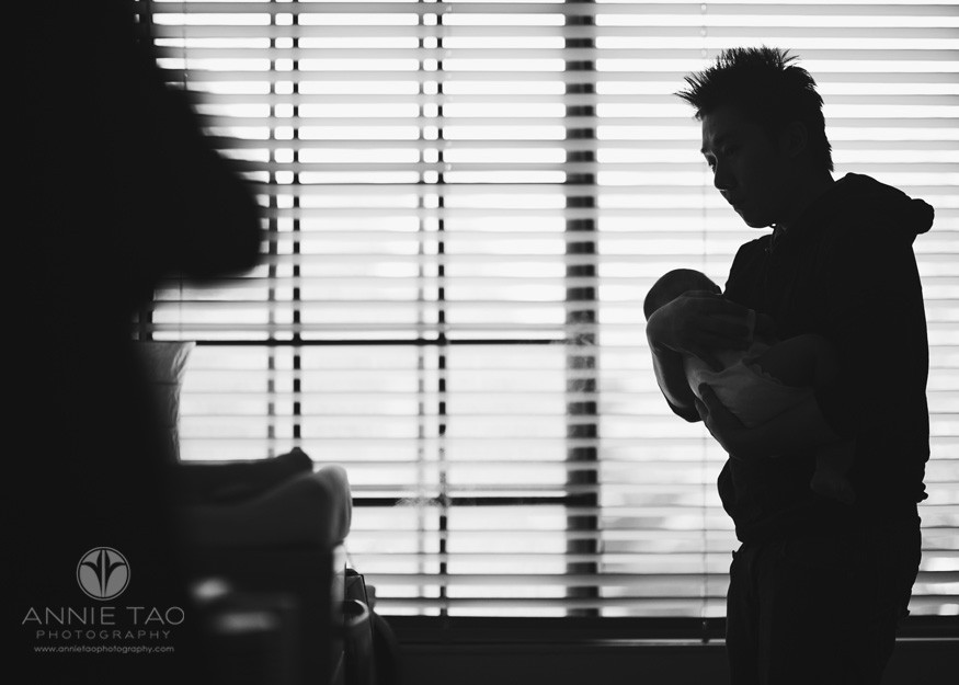 South-Bay-lifestyle-baby-photography-dad-rocking-baby-BxW-silohouette
