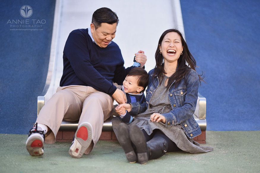 san-francisco-lifestyle-family-photography-family-laughing-at-bottom-of-slide