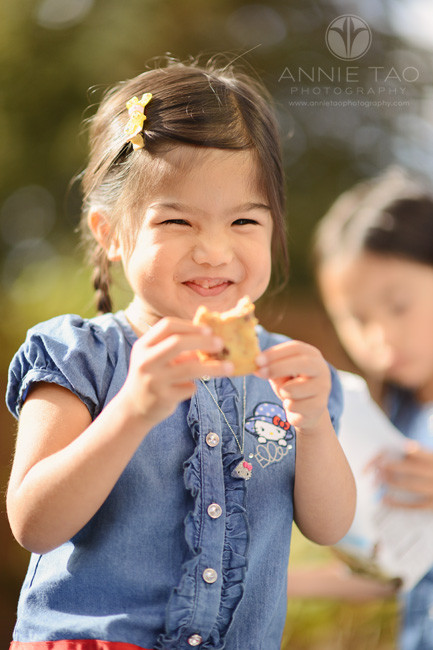 East-Bay-lifestyle-children-photography-preschool-girl-happy-eating-cookie