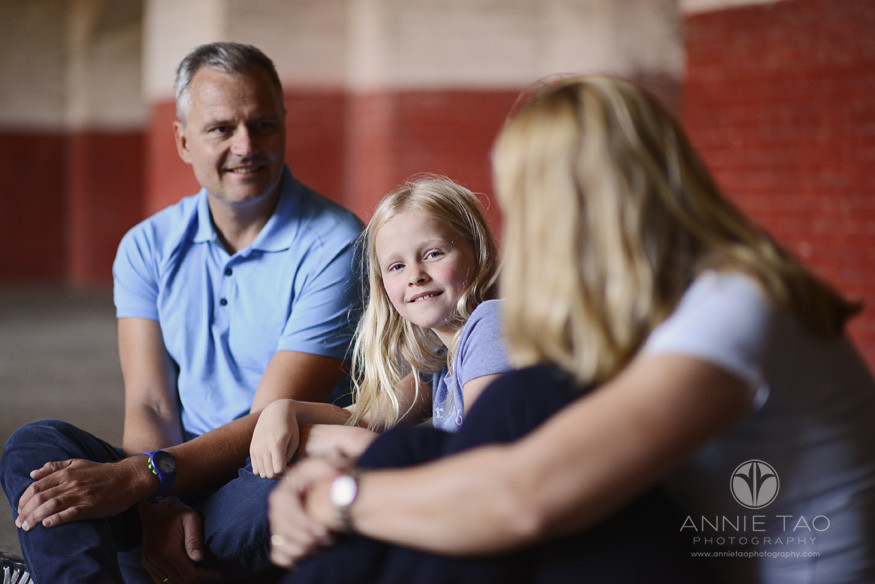 San-Francisco-lifestyle-family-photography-girl-looking-over-while-sitting-with-family