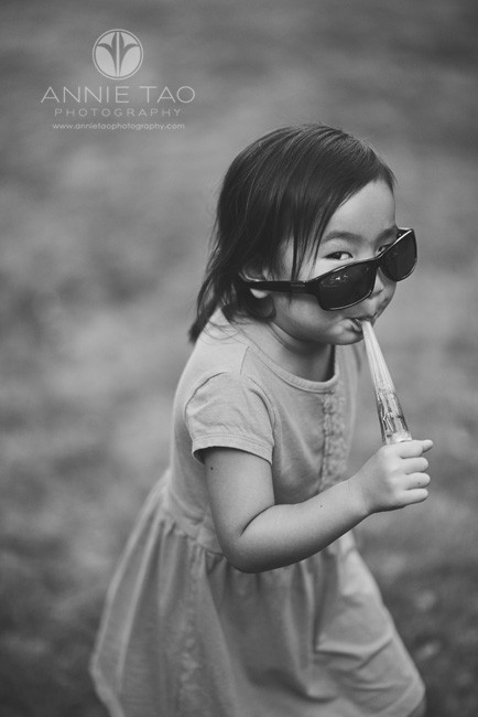 San-Francisco-Bay-Area-Peninsula-lifestyle-children-photography-girl-walking-away-with-candy-and-crooked-glasses-BxW
