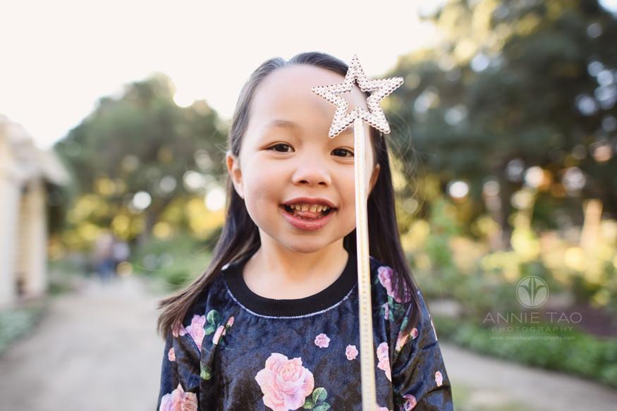 Bay-Area-lifestyle-children-photography-preschool-girl-holding-fairy-wand-in-garden