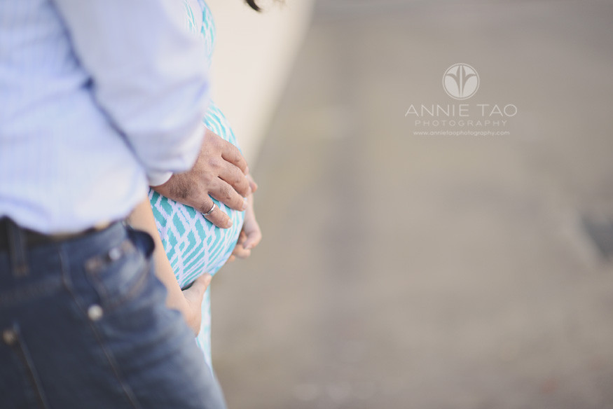 San-Francisco-lifestyle-maternity-photography-couple-holding-baby-belly-sideview