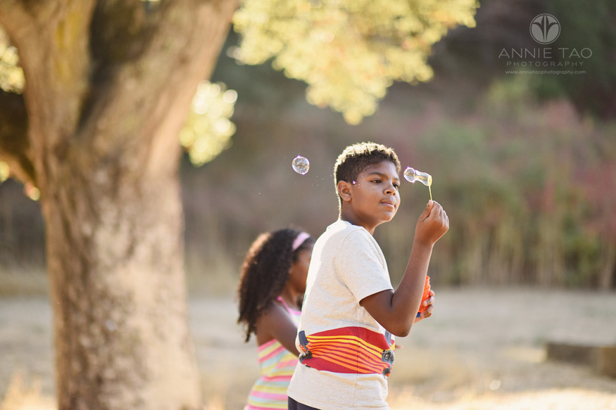 Bay-Area-lifestyle-children-photography-boy-letting-wind-blow-his-bubbles