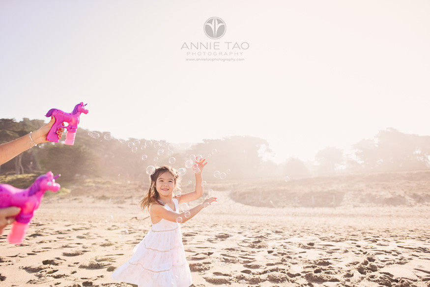 San-Francisco-lifestyle-children-photography-young-happy-girl-running-with-bubbles-at-beach