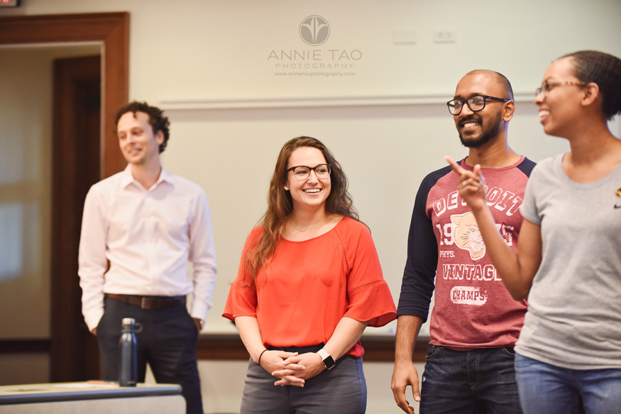 Commercial-Photography-Rice-Business-School-smiling-students-presenting-in-class-with-professor-listening