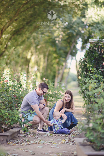 East-Bay-lifestyle-family-photography-one-year-old-boy-sitting-with-parents-in-rose-garden