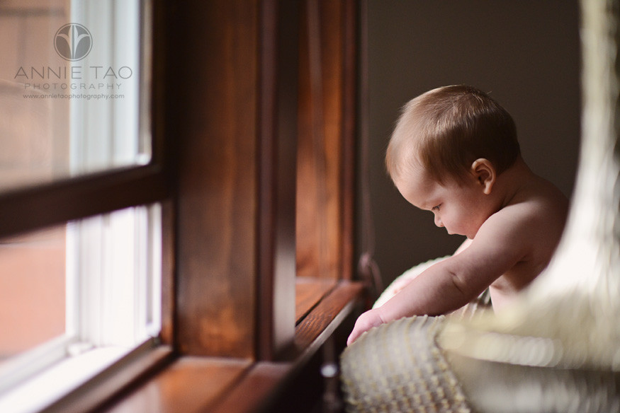 North-Bay-Marin-lifestyle-baby-photography-naked-baby-looking-down-by-window-BxW