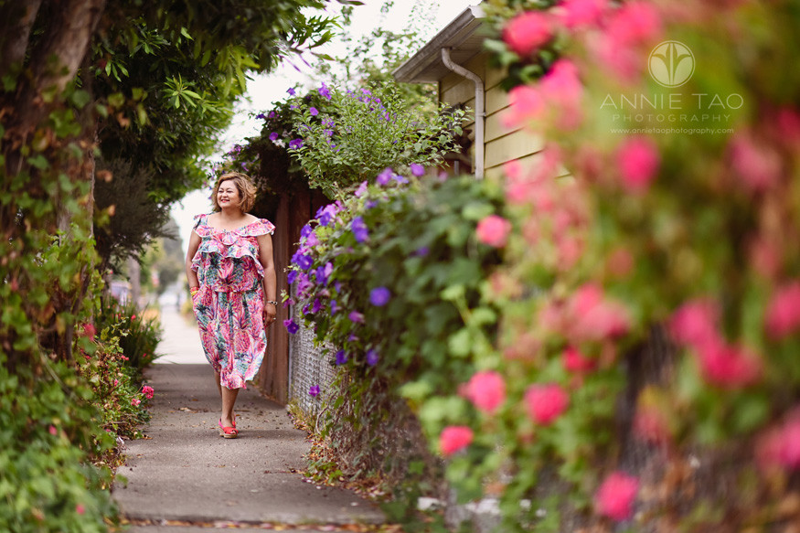 East-Bay-styled-photography-woman-walking-down-garden-alley