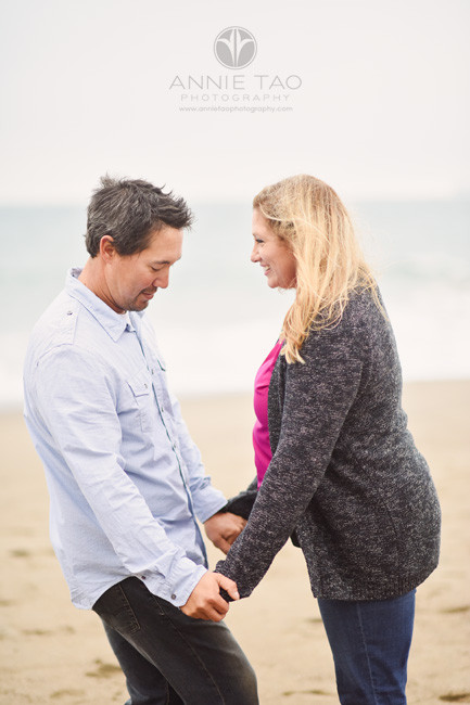 San-Francisco-engagement-photography-couple-facing-each-other-on-beach