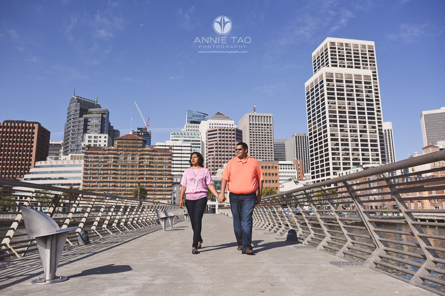 San-Francisco-lifestyle-couple-photography-couple-walking-together-on-pier-downtown