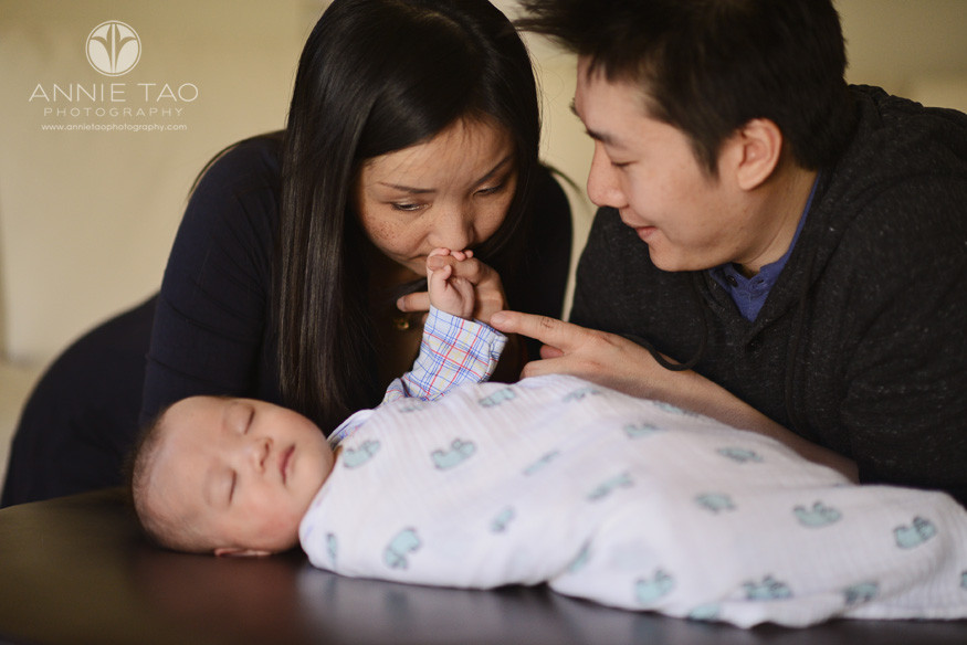 South-Bay-lifestyle-baby-photography-mom-kissing-her-babys-hand-while-he-sleeps