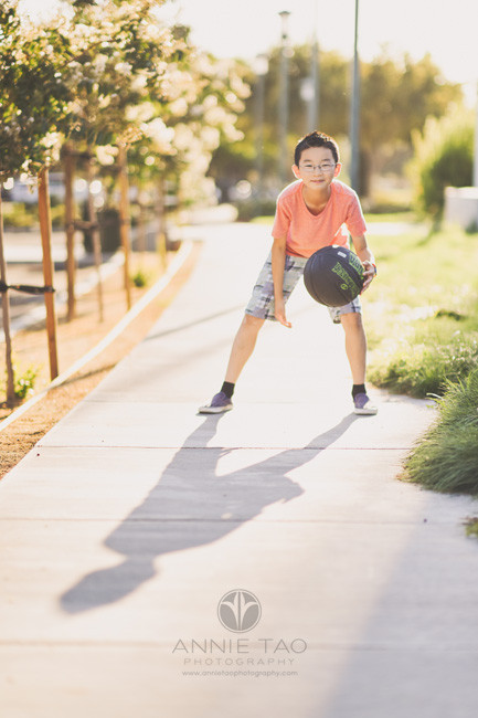 East-Bay-lifestyle-children-photography-boy-dribbling-basketball-in-golden-hour