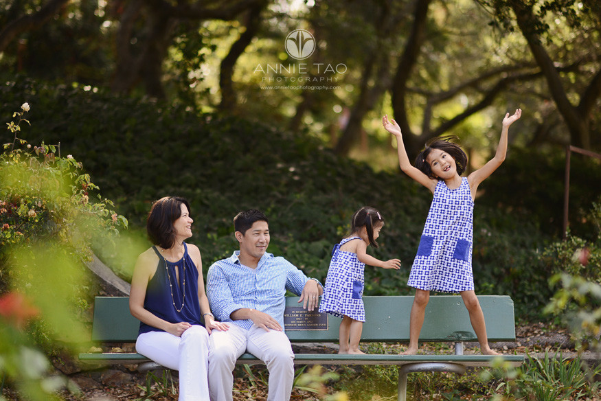 East-Bay-lifestyle-family-photography-parents-sitting-on-bench-and-watching-dancing-daughters