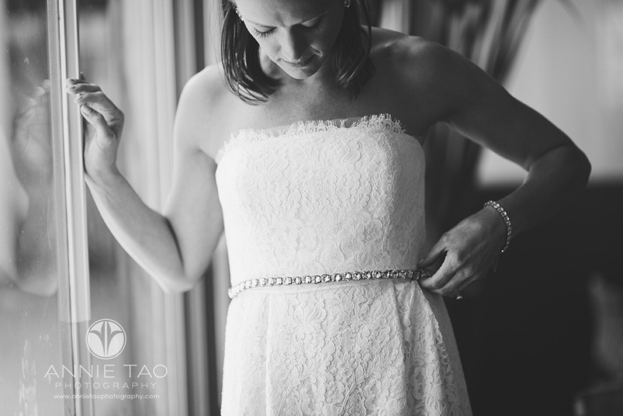 San-Francisco-wedding-photography-gay-wedding-bride-fixing-belt-by-window