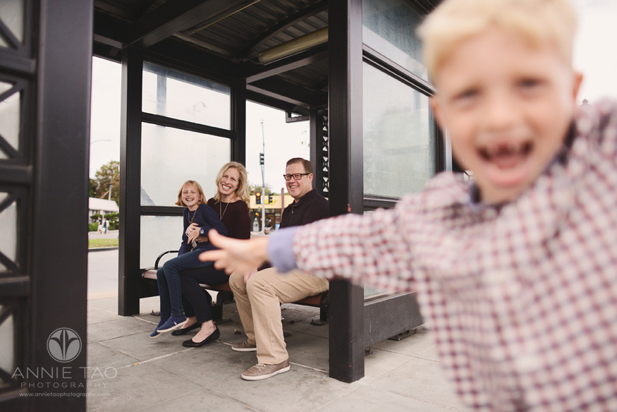 Bay-Area-lifestyle-family-photography-young-boy-photobombs-his-family-at-bus-station
