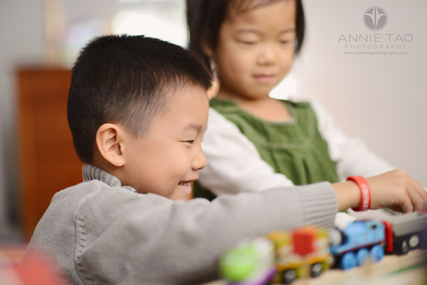 East-Bay-lifestyle-children-photography-young-boy-playing-trains-with-younger-sister