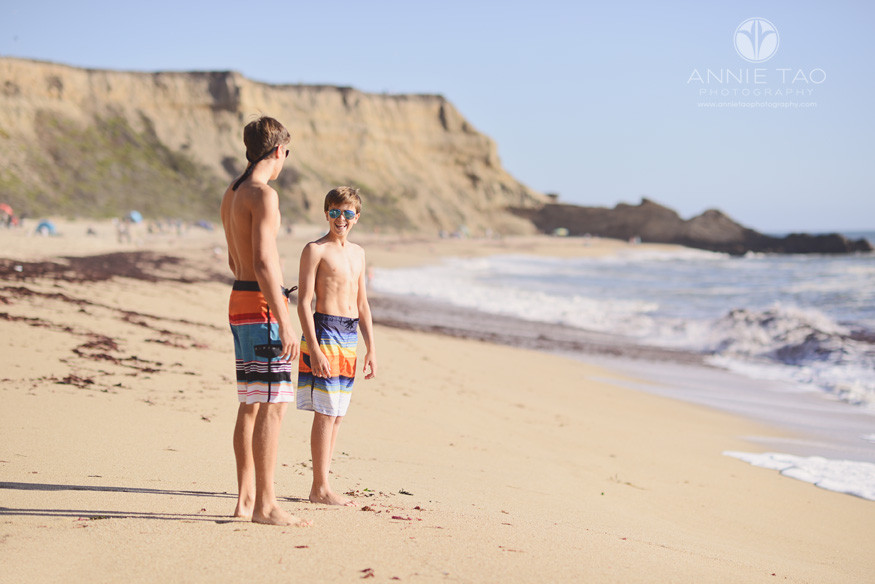 Bay-Area-lifestyle-teen-photography-teen-boy-smiling-at-older-brother-on-beach