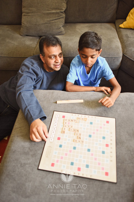 East-Bay-lifestyle-home-photography-father-playing-scrabble-with-son-in-livingroom