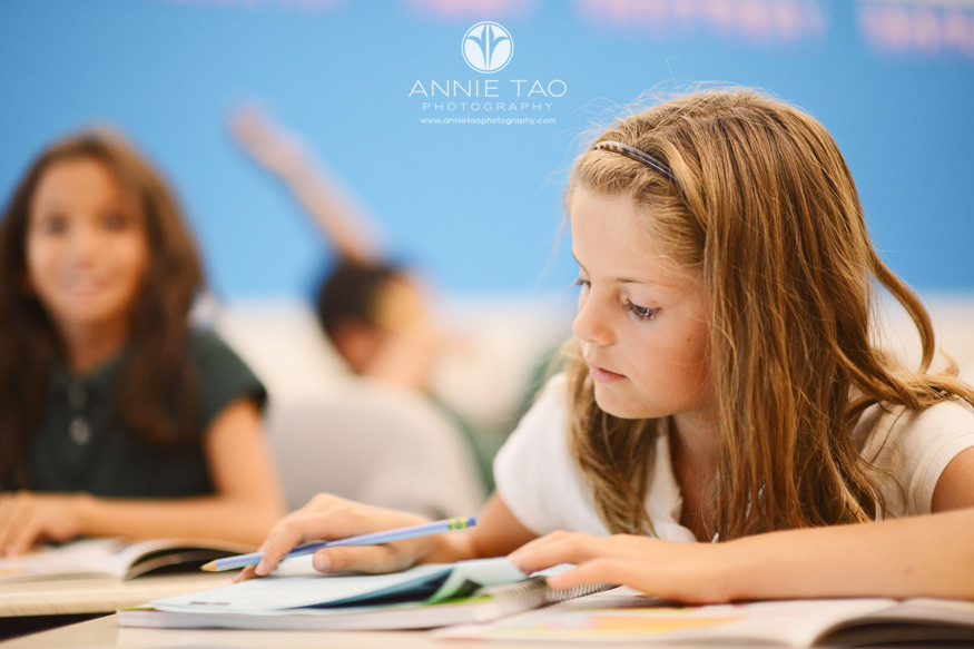 San-Francisco-Bay-Area-school-photography-student-studyingt-textbook-in-class