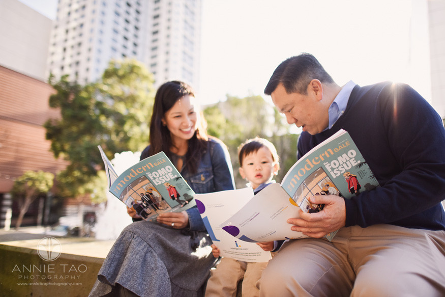 san-francisco-lifestyle-family-photography-parents-reading-magazines-with-toddler-downtown-in-sun