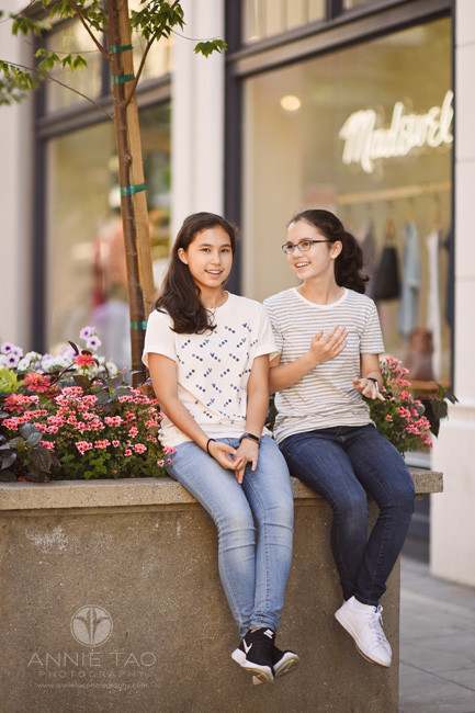 South-Bay-lifestyle-teen-photography-sisters-chatting-by-flower-bed