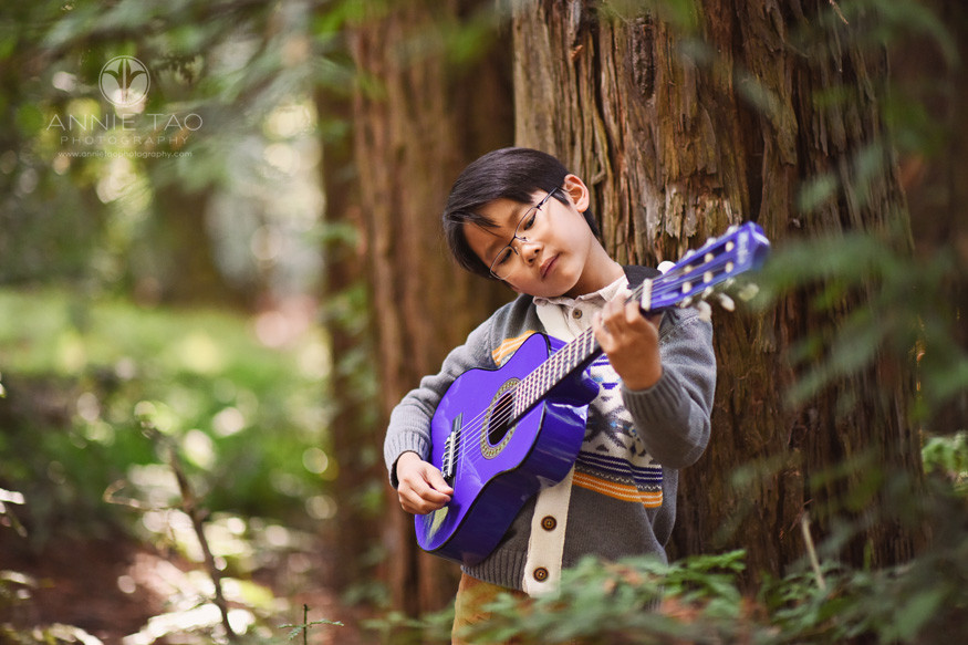 East-Bay-lifestyle-children-photography-young-boy-playing-guitar-in-forest