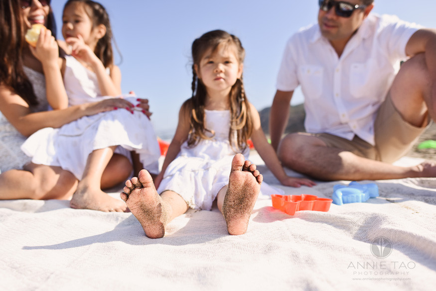 San-Francisco-lifestyle-family-photography-family-sitting-at-beach-focus-on-little-girls-sandy-toes