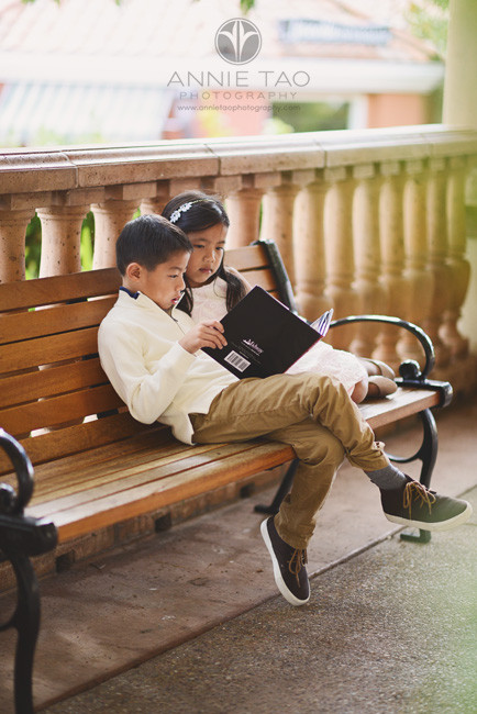 East-Bay-lifestyle-children-photography-young-children-reading-a-book-on-bench
