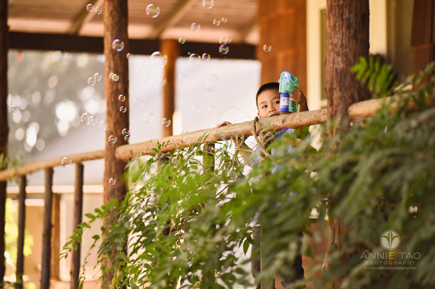 san-francisco-bay-area-lifestyle-children-photography-young-boy-using-bubble-machine-on-wooden-patio
