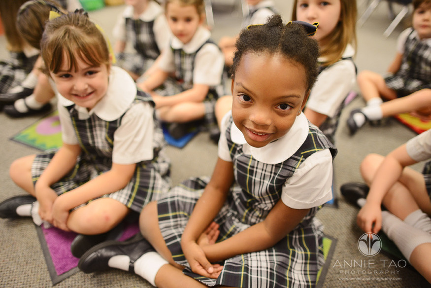 Commercial-education-photography-young-student-sitting-crisscross-on-carpet