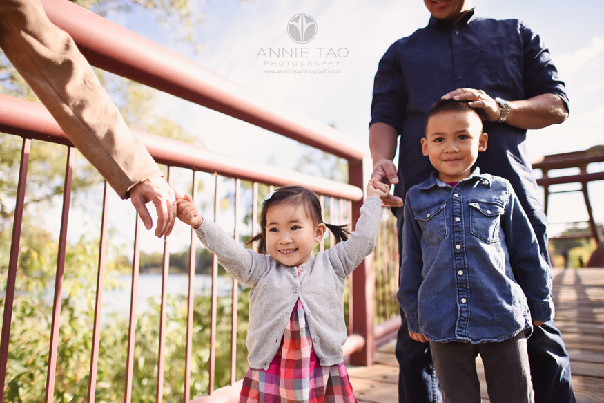 South-Bay-lifestyle-family-photography-toddler-girl-and-preschool-boy-holding-parents-hands-on-bridge