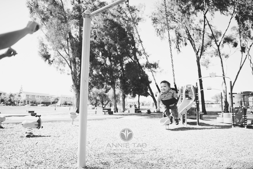 South-Bay-lifestyle-baby-photography-baby-on-swing-with-mom-cheering-BxW