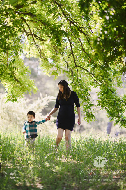 Bay-Area-lifestyle-family-photography-pregnant-woman-holding-toddler-sons-hand-thru-tall-grass