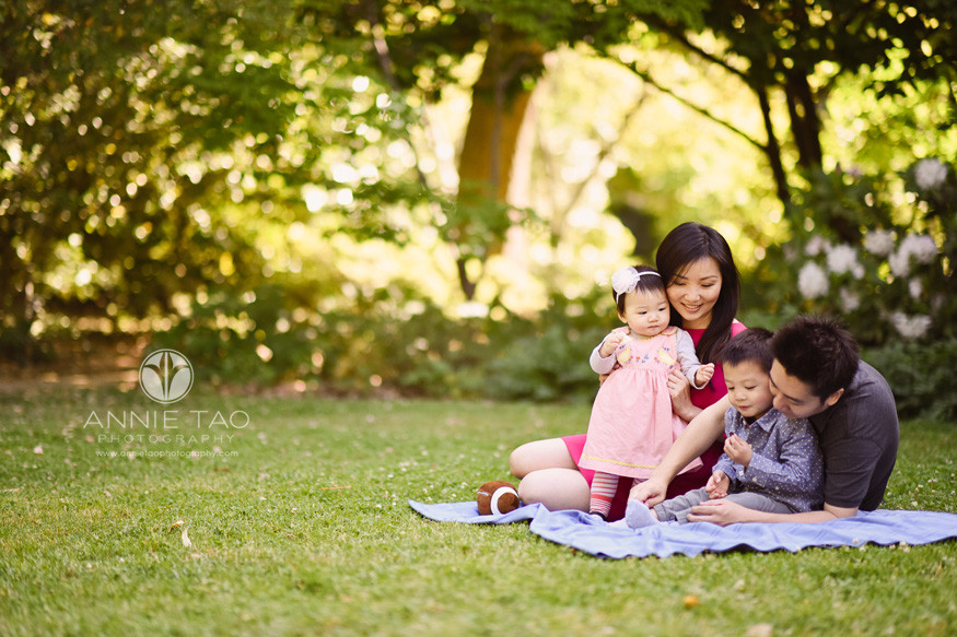 Bay-Area-lifestyle-family-photography-parents-playing-with-young-son-and-baby-girl-on-grass