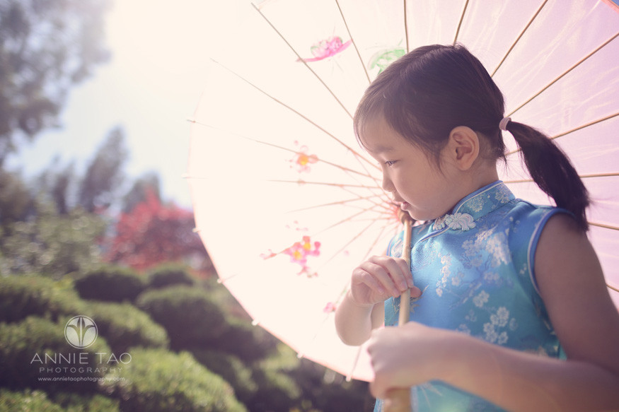 East-Bay-lifestyle-children-photography-young-girl-holding-umbrella-and-looking-away-with-sunflare