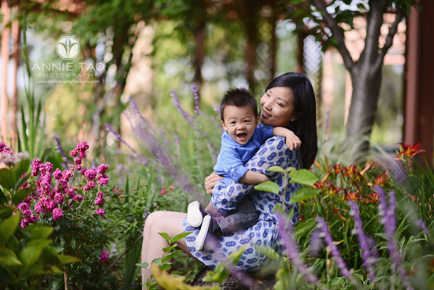 South-Bay-lifestyle-family-photography-mother-holding-an-excited-son-in-garden