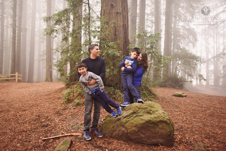 East-Bay-lifestyle-family-photography-parents-playing-with-young-sons-on-rock-in-forest