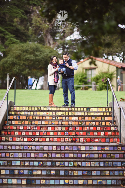 San-Francisco-lifestyle-baby-photography-parents-holding-baby-on-top-of-stairs-with-painted-tiles