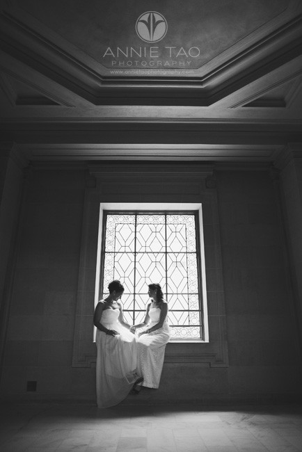 San-Francisco-wedding-photography-City-Hall-gay-wedding-brides-having-a-quiet-moment-by-the-window-BxW