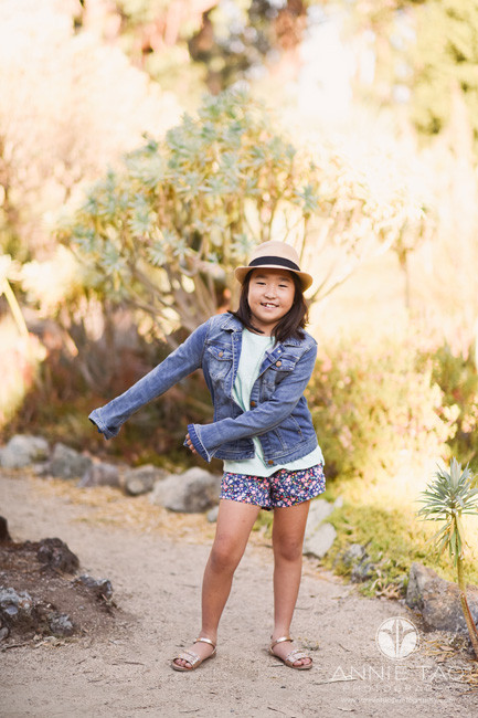 San-Francisco-Bay-Area-lifestyle-children-photography-girl-flossing-in-cactus-garden