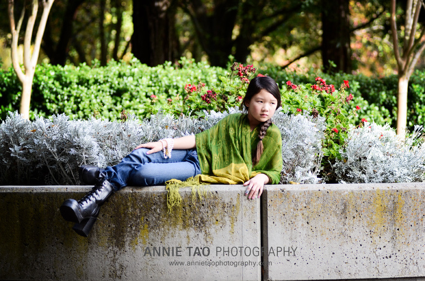 Preteen-model-styled-photography-dressed-in-green-laying-down