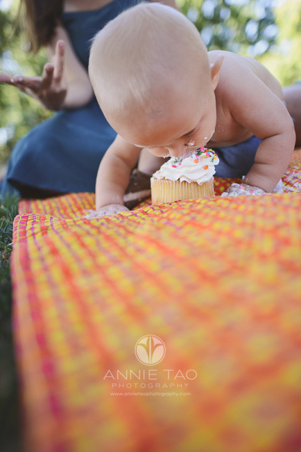 East-Bay-lifestyle-baby-photography-baby-boy-demolishing-cake-with-his-face-floor-view