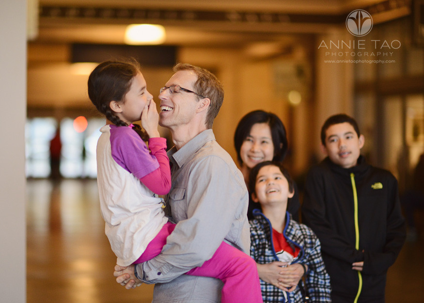 San-Francisco-lifestyle-family-photography-dad-holding-youngest-child-while-the-rest-of-the-family-watches