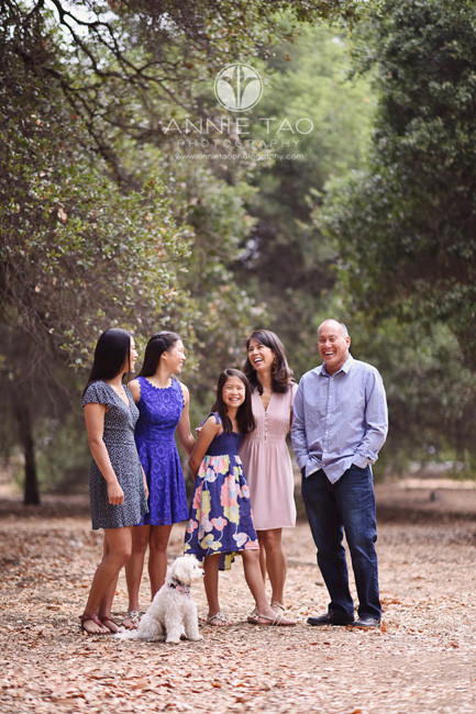 Bay-Area-lifestyle-family-photography-laughing-together-with-puppy-among-trees